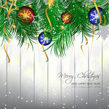 Christmas background with bauble, pine needles and wooden texture for greeting card and happy holiday Stock Photo