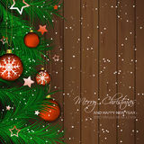 Christmas background with bauble, pine needles and wooden texture for greeting card and happy holiday Stock Photography