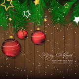 Christmas background with bauble, pine needles and wooden texture for greeting card and happy holiday Royalty Free Stock Images
