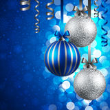 Christmas background with baubles. Christmas background with blue and silver baubles Royalty Free Stock Photo