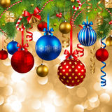 Christmas background with baubles. Christmas background with fir, red, blue and golden baubles Royalty Free Stock Image