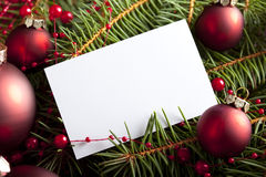 Christmas background - baubles and blank paper card Royalty Free Stock Photos