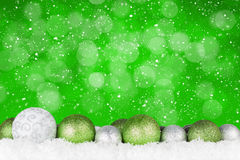 Christmas background with baubles and bokeh. Copy space Royalty Free Stock Images