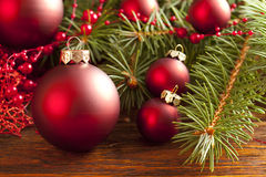 Christmas background - baubles and branch of spruce tree Stock Images