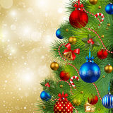 Christmas background with baubles and christmas tr. Christmas background with red, golden and blue baubles on christmas tree Royalty Free Stock Photo
