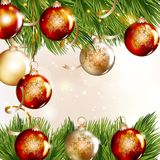 Christmas background with baubles and fir branches Royalty Free Stock Images