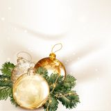 Christmas background with baubles and fir tree branches on a cle Royalty Free Stock Image