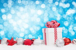 Christmas background with baubles, gift box and bokeh Stock Photography