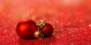 Christmas background with baubles and glitter Stock Photos