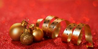 Christmas background with baubles and ribbon Stock Image