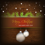 Christmas background with baubles and snow Royalty Free Stock Images