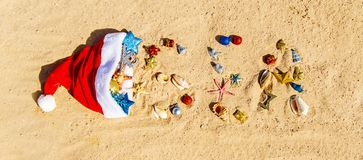 Christmas background on the beach with shells on the sand stock photos