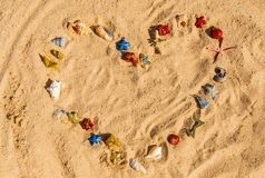 Christmas background on the beach with shells on the sand royalty free stock image