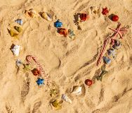 Christmas background on the beach with shells on the sand royalty free stock photo