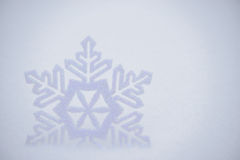 Christmas Background with Beautiful Snowflake on the Snow Stock Photography