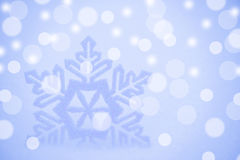 Christmas Background with Beautiful Snowflake on the Snow Stock Photo