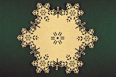 Christmas background with beige snowflakes and copy space on xmas green background Royalty Free Stock Images