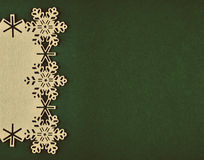 Christmas background with beige snowflakes and copy space on xmas green background Stock Photo