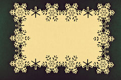 Christmas background with beige snowflakes and copy space on xmas green background Royalty Free Stock Photos