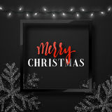 Christmas background black color with realistic garlands and beautiful snowflakes in the frame. Royalty Free Stock Photography