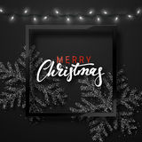 Christmas background black color with realistic garlands and beautiful snowflakes in the frame. Royalty Free Stock Images