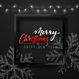 Christmas background black color with realistic garlands and beautiful snowflakes in the frame. Stock Images