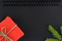 Christmas background on a black notepad sheet royalty free stock photo
