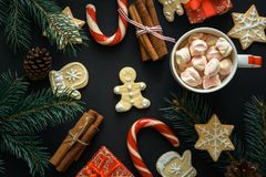 Christmas background on the black wooden desk. Top view Stock Photos