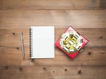 Christmas background with blank notebook, decorations and gift b royalty free stock photography