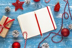 Christmas background with blank notebook, decorations and gift b Stock Image