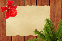 Christmas Background. Blank Old Paper Sheet with Decoration. Ball and christmas tree branch Stock Photos