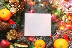 Christmas background blank paper and decoration with garland Royalty Free Stock Photography