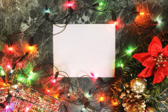 Christmas background blank paper and decoration with garland Royalty Free Stock Photos