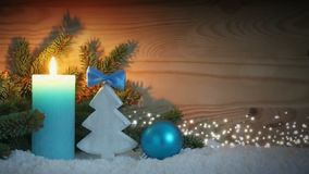 Advent candle and blue decoration with snow. Christmas background. stock video