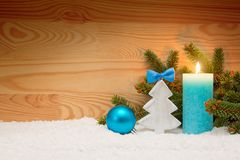 Advent candle and wood fir tree . Christmas background. Royalty Free Stock Images