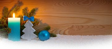 Advent candle and wood fir tree . Christmas background. Stock Images