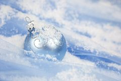 Christmas background / with blue ball and snow stock image