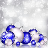 Christmas background blue balls. Beautiful snowflakes and shining stars Stock Photos