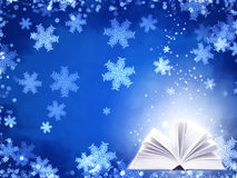 Christmas background of blue color with magic book Stock Photo