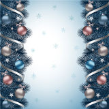 Christmas background blue. Christmas background with blue fir branch border, ribbons and Christmas decorations Royalty Free Stock Image