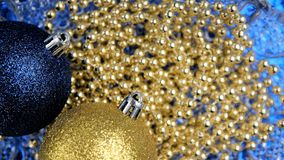 Christmas background,blue and golden xmas ornaments Stock Image