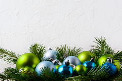 Christmas background with blue, green and glitter ornaments Stock Images