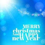 Christmas background on blue luminous rays. Stock Images