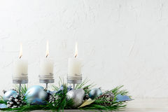 Christmas background with blue ornaments and burning candles Royalty Free Stock Image