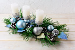 Christmas background with blue ornaments decorated candleholder Royalty Free Stock Photos