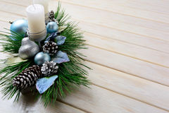 Christmas background with blue ornaments decorated candleholder Stock Images