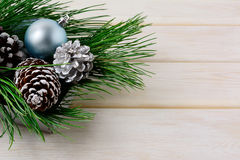 Christmas background with blue ornaments, silver and snowy pinec Royalty Free Stock Photography