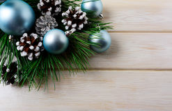 Christmas background with blue ornaments and snowy pinecone Royalty Free Stock Photos