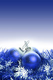 Christmas background with blue ribbon and balls Stock Images