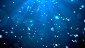 Christmas background blue theme with snowflakes, shiny lights in stylish and elegant theme.  Stock Image